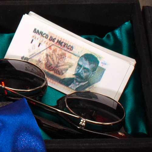 compartment with glasses and fake money